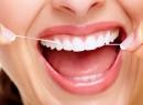 отек десен, зубная нить