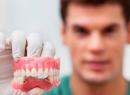 Протезирование зубов с помощью имплантов